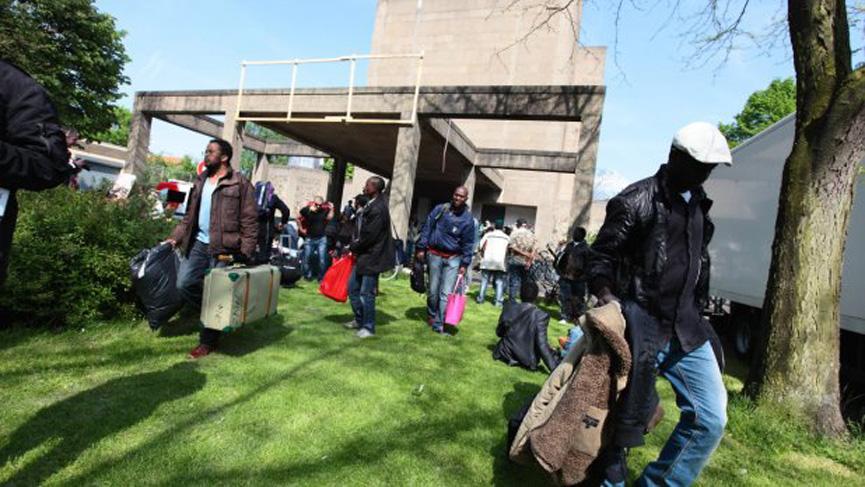 Refugees leaving the Vluchtkerk in early June